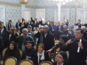 Tunisian citizens participate in a meeting to decide on investments in street lighting